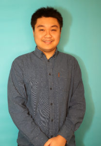 Tech Specialist Josh Ngo, smiling at the camera