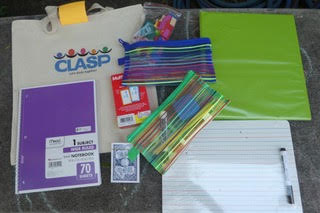 "School supplies and a bag with ""CLASP"" on it"