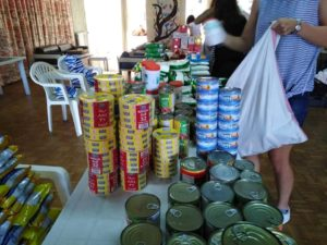 Canned food being distributed to families in need